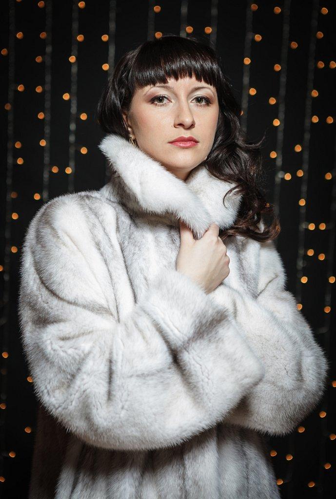 Portrait of beautiful young women in fur coat