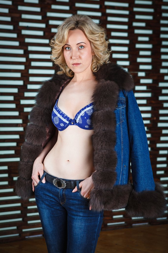 Young woman posing in fur jacket